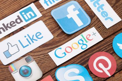 44537943 - kiev, ukraine - august 22, 2015:collection of popular social media logos printed on paper:facebook, twitter, google plus, instagram, pinterest, skype, youtube, linkedin and others on wooden background